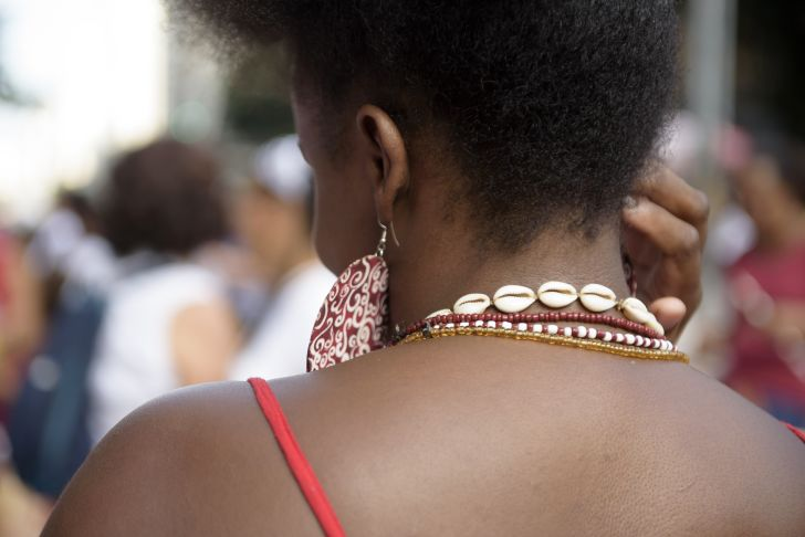 Woman wearing African jewelry viewed from the back