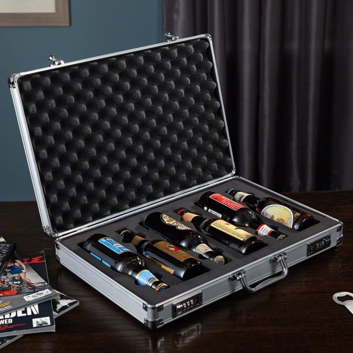 A briefcase on a desk open to reveal six beers inside