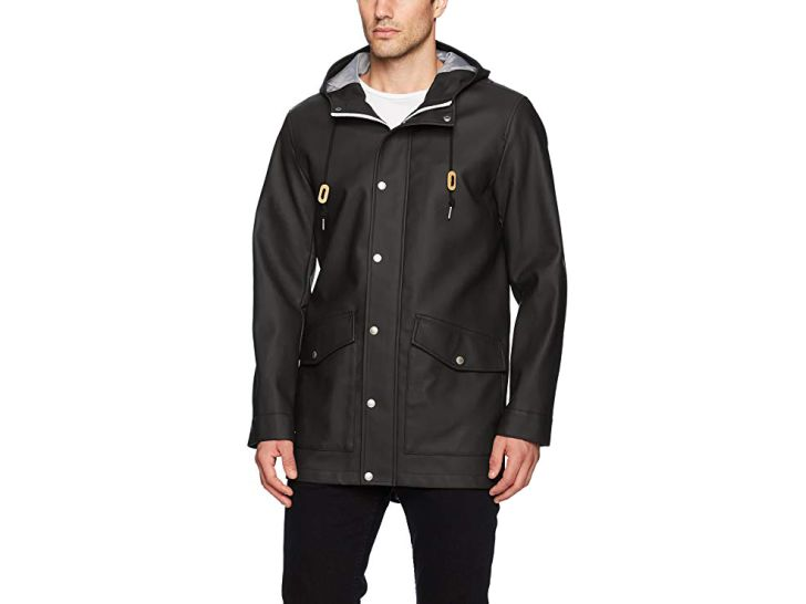 A man in a black faux-rubber jacket