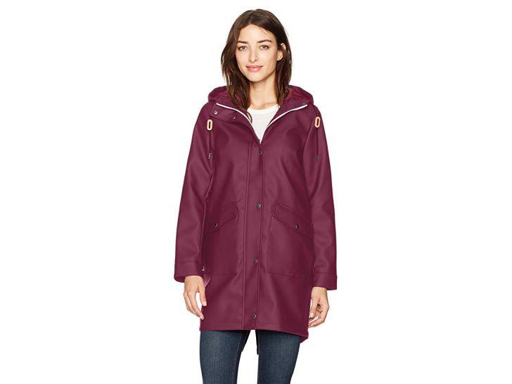A woman in a maroon rain jacket