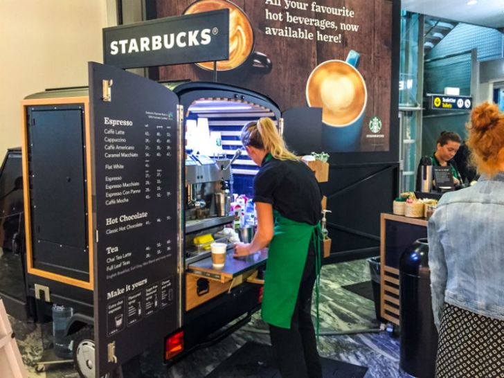 A Starbucks employee prepares an order