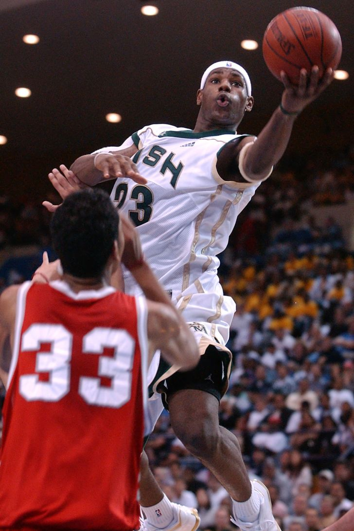 LeBron James goes up for a basket during a game with his St. Vincent-St. Mary's high school team in January 2003.