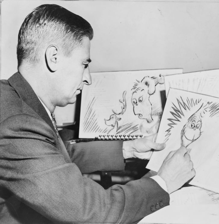 """Ted Geisel, American writer and cartoonist, at work on a drawing of the grinch for """"How the Grinch Stole Christmas"""""""