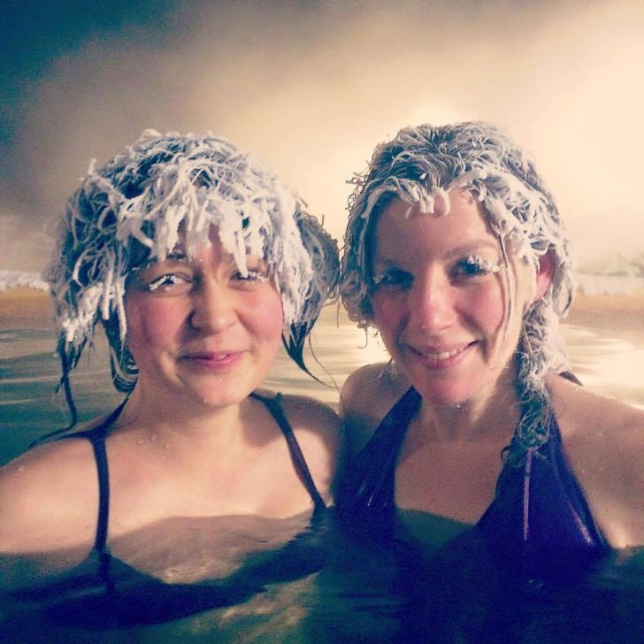 People with frozen hair in hot tub.