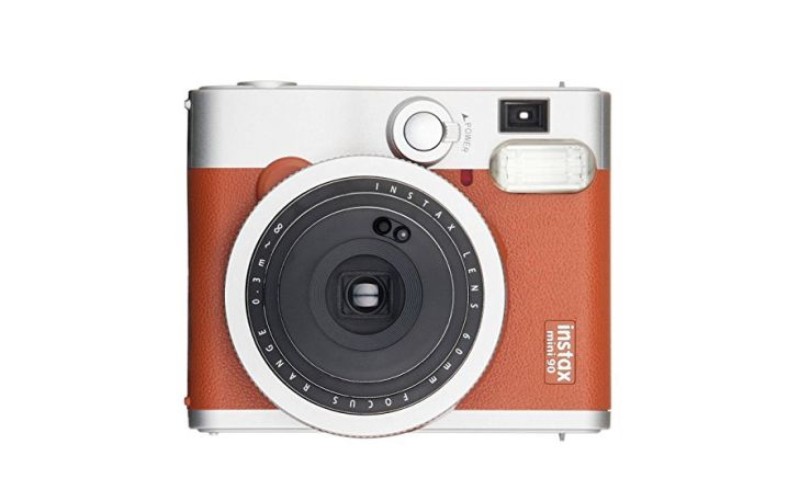 A brown Fujifilm instant camera