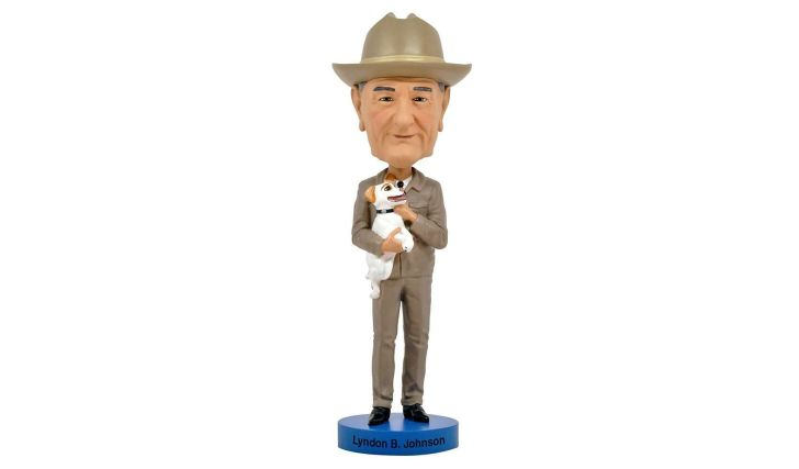 A Lyndon Johnson bobblehead depicting the president holding a dog