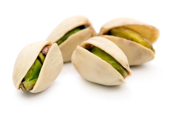 Four pistachios in their shells