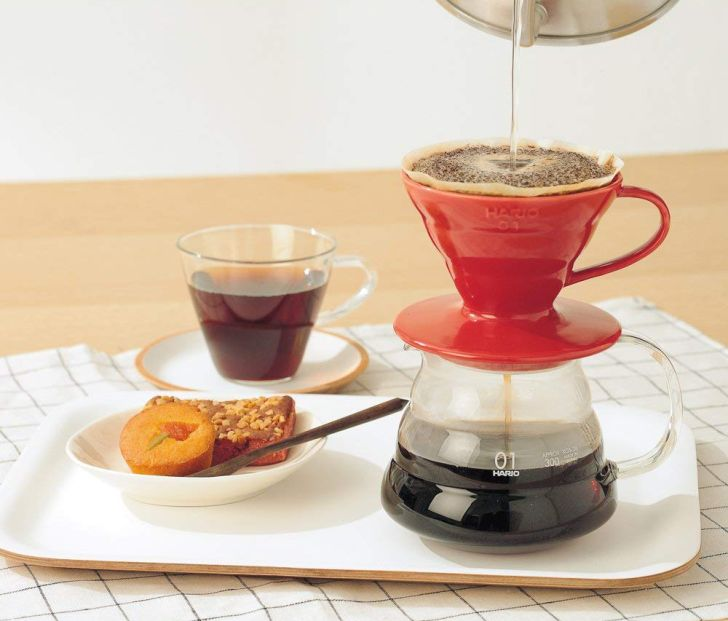 Pouring water into a Hario V60 brewer to make coffee