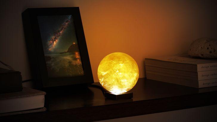 The solar lamp illuminated on a nightstand
