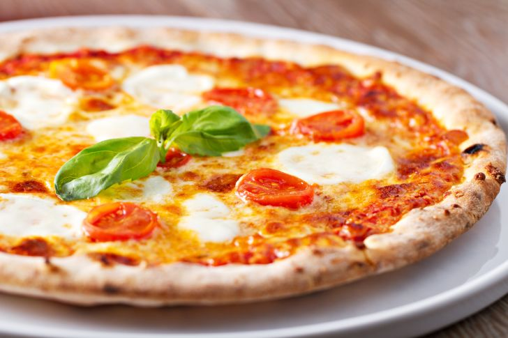A margherita pizza fresh from the oven