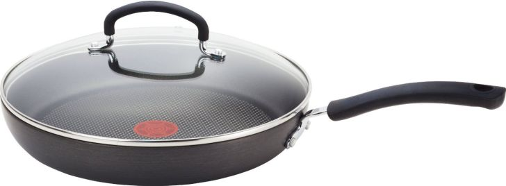 A nonstick pan with a glass lid on it