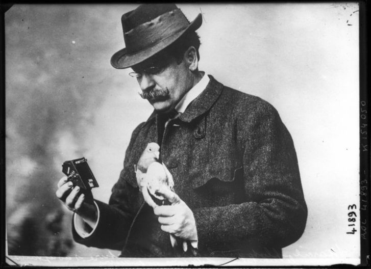 Julius Neubronner with a pigeon