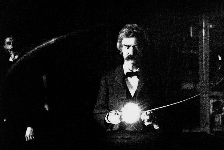 A photograph of Mark Twain holding a vacuum lamp, with Nikola Tesla in the background