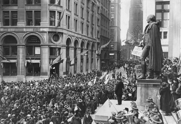 People celebrate the end of World War I on Wall Street in New York City