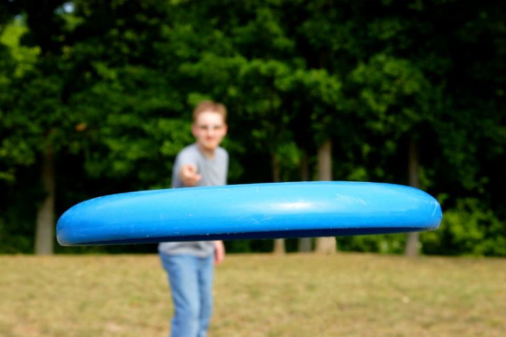 A man throws a Frisbee at the camera