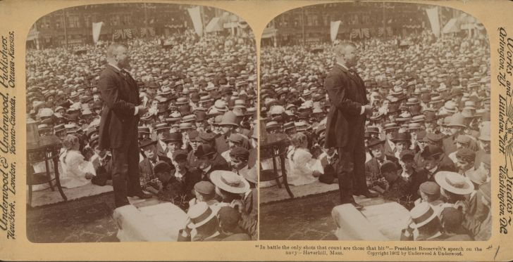 A yellowing stereograph of Teddy Roosevelt in front of a crowd