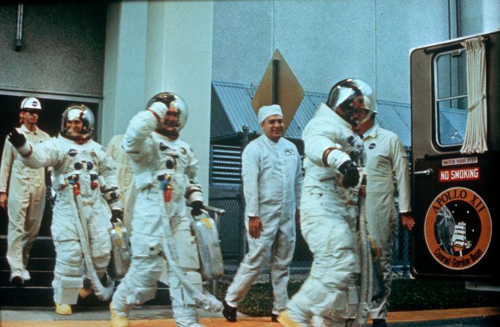 Astronauts Pete Conrad, Richard F Gordon Jnr, and Alan L Bean getting ready to go to the moon on the Apollo 12 mission.