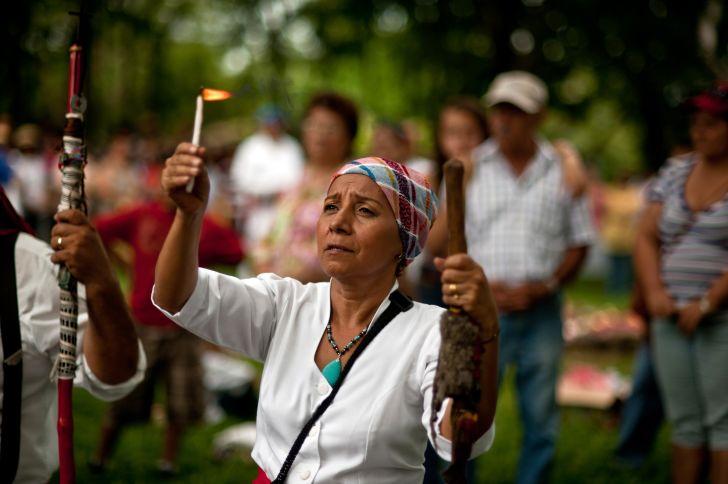 A Maya priestess conducts an autumn equinox ceremony at El Salvador's Cihuatan Archeological Park.