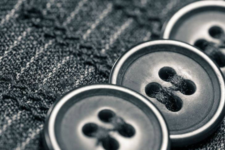 Buttons are seen on a sleeve in close-up