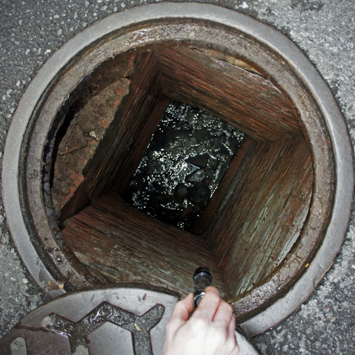 Water pooling at the bottom of a manhole