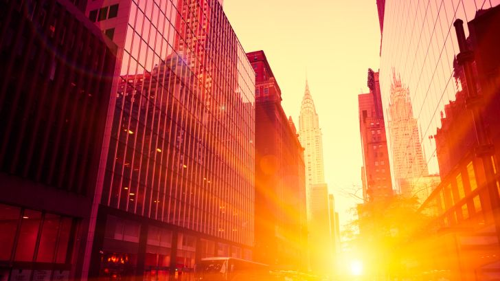 sunlight shining through city streets and buildings