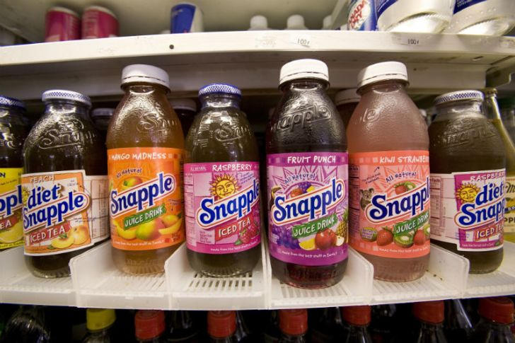 Bottles of Snapple line a store shelf