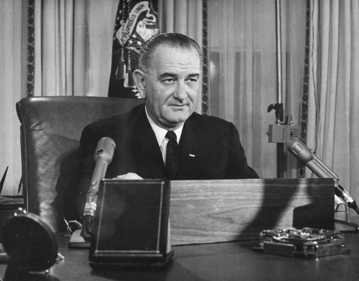 American President Lyndon Baines Johnson addresses the nation on his first thanksgiving day television programme, broadcast from the executive offices of the White House