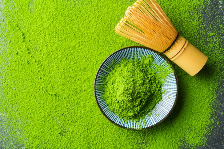 image of green tea matcha powder crushed on a table