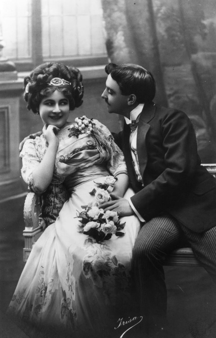 A courting Victorian couple fawning over each other