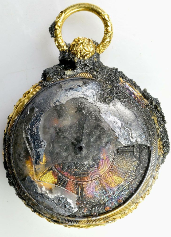 A close-up of the gold pocket watch