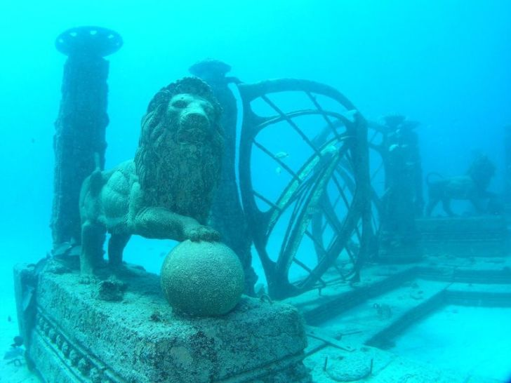 An underwater lion sculpture and other memorials