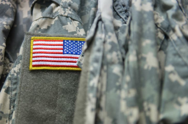 The American flag appears on a military uniform