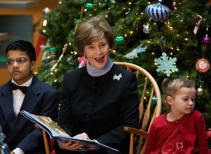 First Lady Laura Bush reads a story about 'Rudolf the Red Nose Reindeer' during a visit to the Children's National Medical Center in 2007.