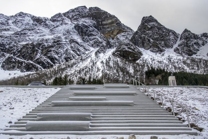 A view up the stairs of the amphitheater toward steep mountains