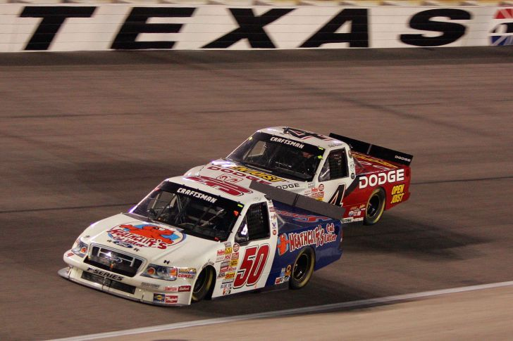 T.J. Bell, driver of the #50 Heathcliff's Cat Litter Ford leads Joe Ruttman, driver of the #4 Open Joist Dodge during the Sam's Town 400 at Texas Motor Speedway June 8, 2007 in Fort Worth, Texas