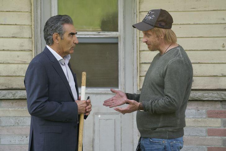 Eugene Levy as Johnny Rose and Chris Elliott as Roland Schitt in Schitt's Creek.