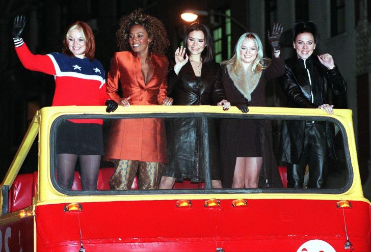 The Spice Girls arrive atop a double decker bus for a screening of their new movie 'Spice World' in New York.