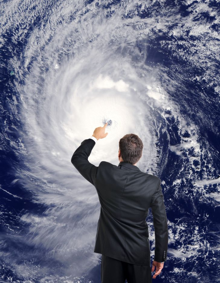 A meteorologist forecasting a hurricane