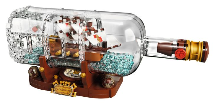 A product shot of a LEGO ship in a bottle against a white background