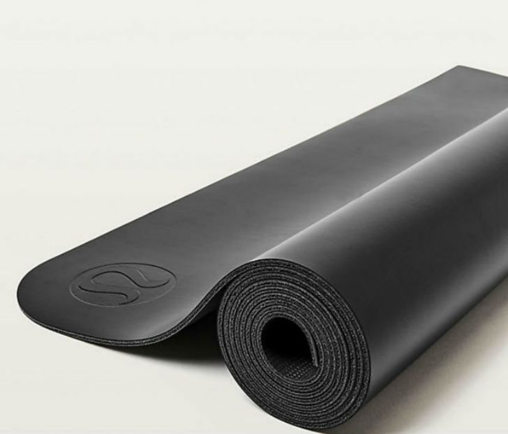 A Lululemon yoga mat appears rolled up