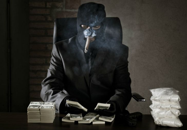 A drug dealer counts his profits from mailing drugs via FedEx