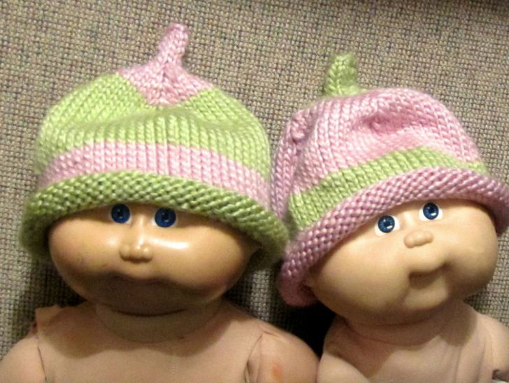 A set of Cabbage Patch Kids wearing hats