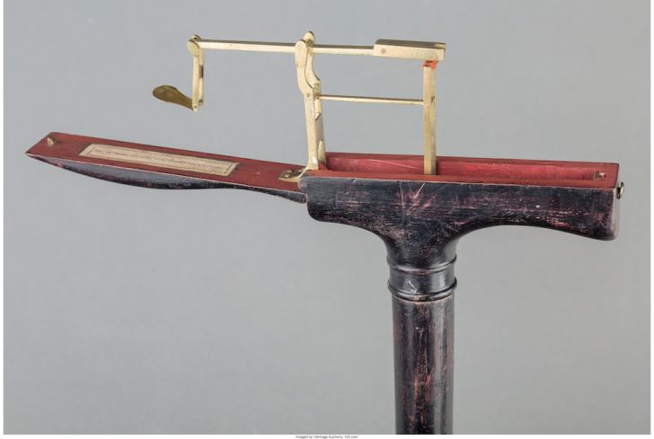 Cane with a weight in the handle.