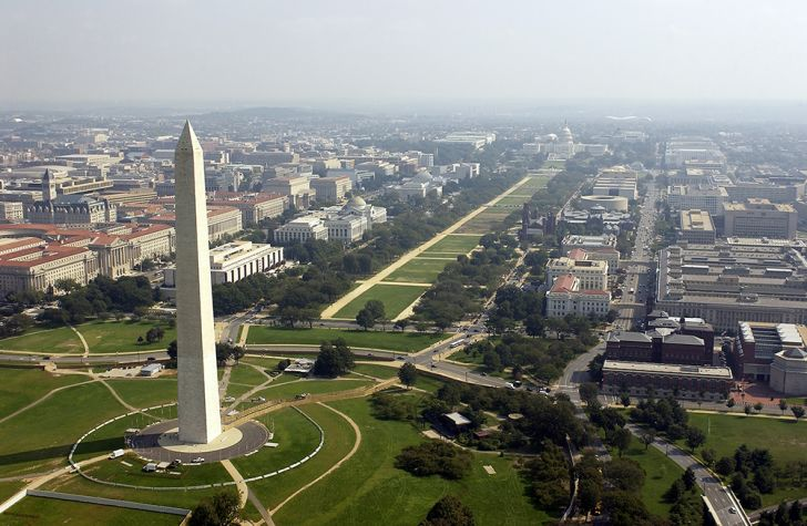 Aerial photo of the Washington Memorial with the Capitol in the background