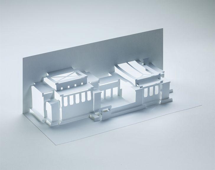A folded paper model of Frank Lloyd Wright's Unity Temple