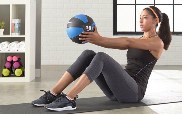 A woman using a medicine ball to exercise