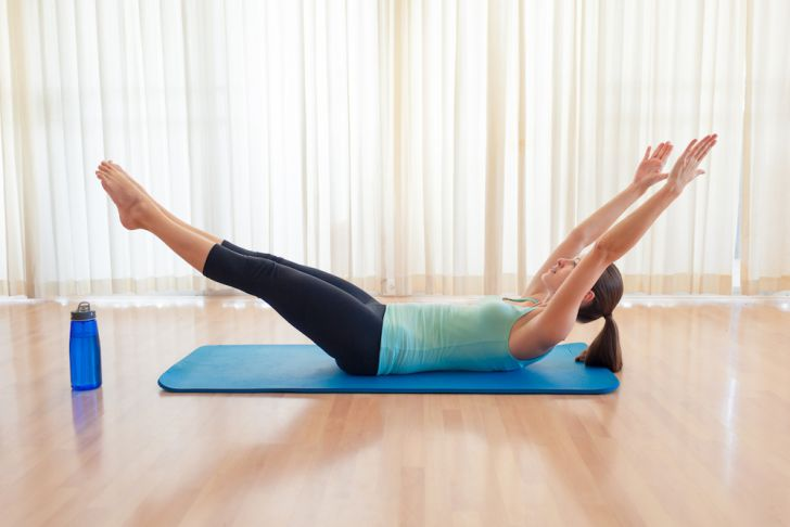 Woman doing a V-up exercise