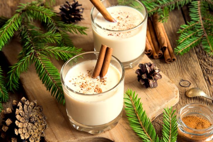 A photo of two glasses of eggnog