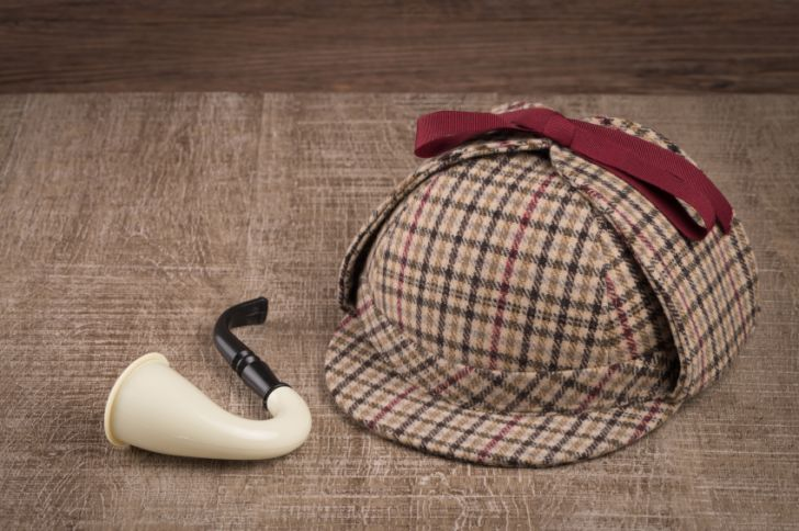 A deerstalker hat and tobacco pipe