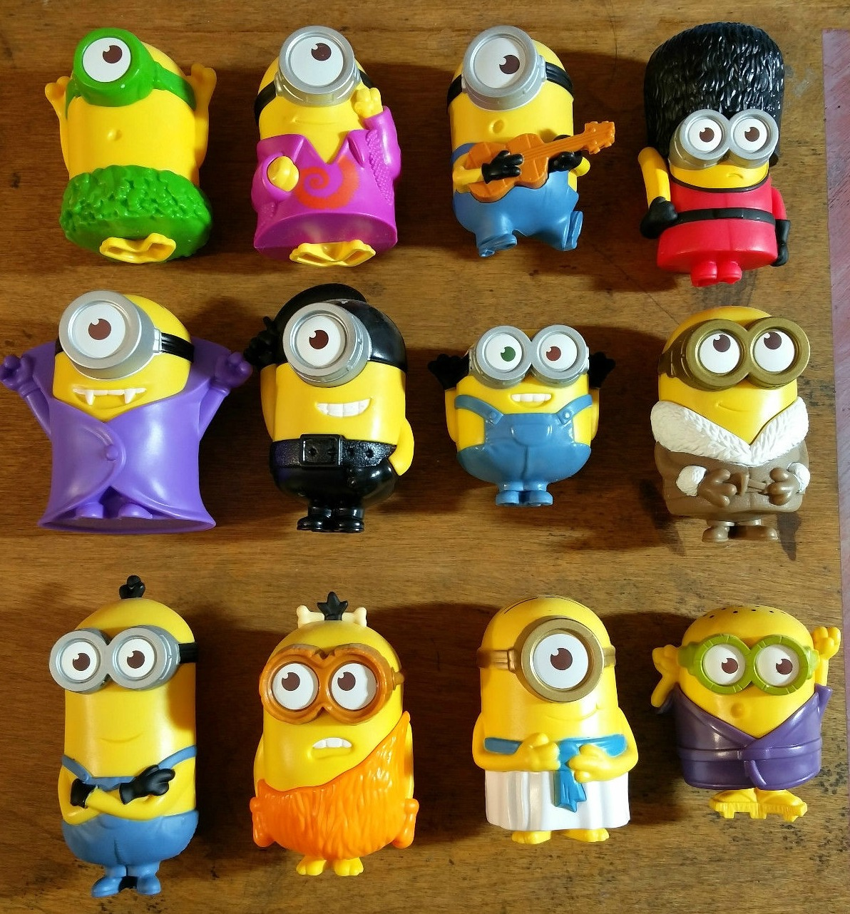 10f71c4fb5 Rows of McDonald s Minion happy meal toys on a wooden background.